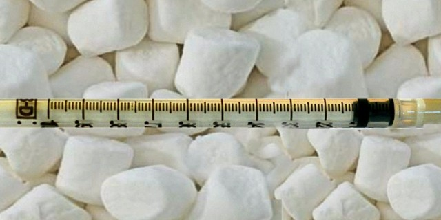 picture of marshmallows and needles